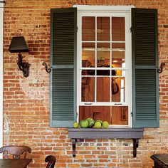 I really like the shutters on the pass through window from Southern Living it seems like this would look great on either side of door to a sunroom.