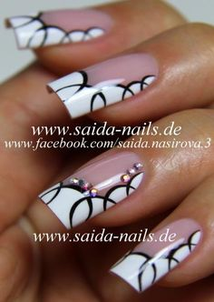 Saida Nails - White French nail art with circles and rhinestones