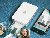 "Print brilliant, life-like photos without ink. This pocket-sized printer activates colored crystals inside the paper, letting you print pics. You can ""print"" videos, too!"