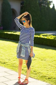 A Patriotic Look - stripe dress, jean jacket, mirrored aviators, red sandals and navy clutch.