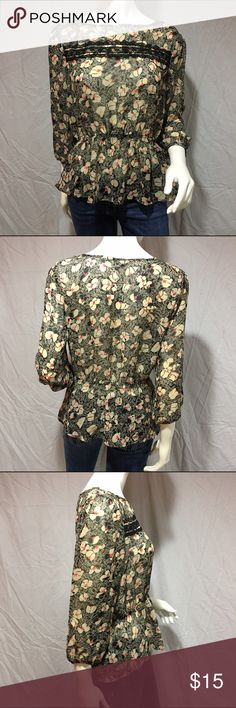 Sheer peplum top Sheer peplum top with flowers. Has a small lace inset across the chest. Has long sleeves that clench at the bottom. In great condition. Feel free to make me a reasonable offer 💕 Lily Rose Tops Blouses