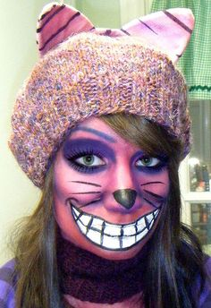 Chesire cat is a wonderfully baffling character found in Lewis Carroll's 'Alice in Wonderland.' I say baffling because he usually engaged in philosophical conversation with Alice which left her, well, baffled. Cheshire Cat Face Paint, Cheshire Cat Makeup, Kitty Face Paint, Cheshire Cat Costume, Cheap Halloween Costumes, Cat Costumes, Halloween Cosplay, Halloween Make Up, Halloween Face Makeup