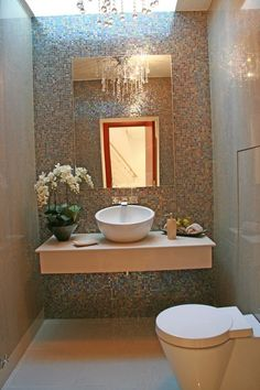 Powder Room Contemporary Cantilevered Sink Decorative Ideas With Downstairs Toilet Flowers Metallic Tile Mirror Recessed Lighting Tile Wall Under S