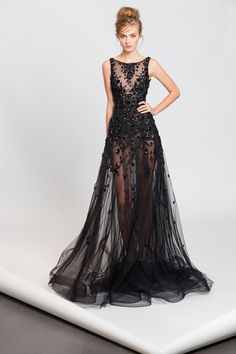 Black see-through evening dress featuring crystal and silk thread embroideries.