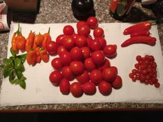 A little harvest from today: [L-R] Basil tangerine dream peppers roma tomatoes how Hungarian wax peppers red currant tomatoes. Time to make tomato and chili soup! #gardening #garden #DIY #home #flowers #roses #nature #landscaping #horticulture