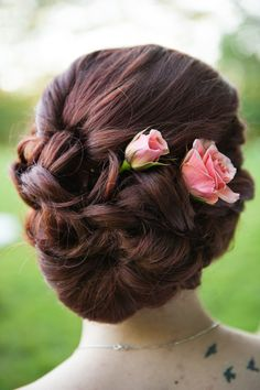 Beautiful Wedding Updo Hairstyle With Fresh Pink Roses | Photo: Laura Matthews…