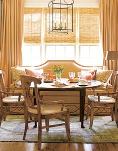 Pumpkin Hues Peachy shades of orange set the mood in this cheerful North Carolina breakfast room by designer Kathy Smith. The banquette is in a washable faux-leather. The curtains are in Henley by Rogers & Goffigon. The chandelier is vintage. Kitchen Banquette, Banquette Seating, Fall Color Schemes, Cozy Room, Beautiful Homes, House Beautiful, Beautiful Kitchens, Outdoor Furniture Sets, House Design