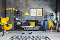 Photo about Table on black and white carpet in hygge style living room with designer yellow chair. Image of metal, color, interior - 100831577 Industrial Bedroom, Industrial Interiors, Industrial Bookshelf, Industrial Chair, Industrial Shop, Industrial Apartment, Industrial Living, Industrial Office, Industrial Farmhouse