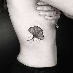Ginkgo leaf on the right side ribcage.