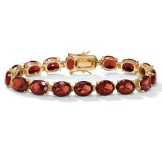 "PalmBeach Jewelry Oval Cut Garnet-Color Glass 14k Yellow Gold-Plated Tennis Bracelet 7 1/4"" Palm Beach Jewelry. $35.98. Save 45%!"