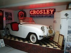 This is a re-creation of an actual store display from the 1940's when Crosley cars were displayed in some stores along side other Crosley products like refrigerators.