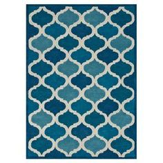 Wool rug with a geometric motif. Hand-tufted in India.   Product: RugConstruction Material: 100% Wool pileColor: Cobalt blueFeatures:  Hand-tuftedMade in India Note: Please be aware that actual colors may vary from those shown on your screen. Accent rugs may also not show the entire pattern that the corresponding area rugs have.Cleaning and Care: Clean spills immediately by blotting with a clean sponge or cloth. Vacuum carefully without beater bar. Expect shedding. Professional cleaning…