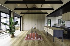 A beautiful big barn conversion featuring textured cupboards from deVOL's Sebastian Cox Kitchen range
