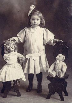 Vintage photo of a girl with her toys ... A doll and Teddy bear sitting in great little chairs.
