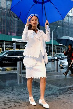 Rihanna holds an umbrella while braving the rain on Saturday (March 14) in New York City.  The 27-year-old entertainer has been busy promoting her upcoming film Home, which hits theaters on Friday, March 27.