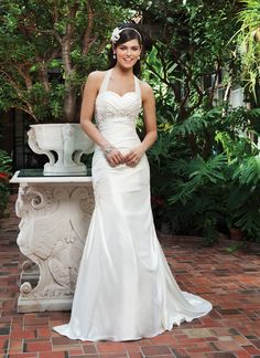 Sincerity wedding dress style 3729 A sweetheart neckline with beaded trim at the empire waist complement  this pleated mermaid done in asymmetric charmeuse. The back is lace up  and has a sweep length train. Comes with a detachable halter collar.