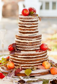 """Brides.com: . This cake has a wonderful homemade quality: alternating layers of apple cake and cream-cheese frosting are stacked high to create this """"inside-out"""" design. The finished confection is brushed with a citrus glaze and adorned with fresh apples, leaves, and a dusting of powdered sugar.  Cake design by Carried Away Cuisine"""