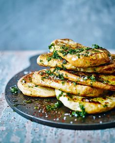 Warm flatbreads, drizzled with a lemony herb butter and scattered with chilli flakes, are the perfect side for any Middle Eastern meal. These flatbreads would go perfectly with this lamb and aubergine stew with houmous. Vegetarian Recipes, Cooking Recipes, Healthy Recipes, Meze Recipes, Lamb Recipes, Good Food, Yummy Food, Tasty, Flatbread Recipes