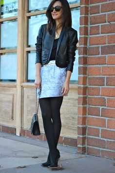Edgy leather jacket paired with an otherwise classic look