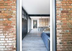 Marta Nowicka & Co transformed a former St John's Ambulance Station to create a family retreat featuring exposed brick walls and industrial-style finishes