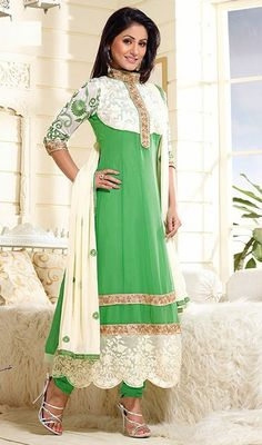 Look enthralling and beautiful dressed in the style of Hina Khan with this ivory and lime green embroidered georgette churidar suit. Beautified with floral patch, lace and resham work.   #LatestBollywoodFancyAnarkaliDress