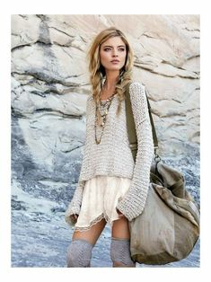 I love this funky outfit-from the hair to the oversized sweater over the dress with grey socks with boots!!