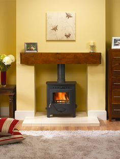 Fireplace Surrounds For Wood Burners. Log Burner Living Room, Home Living Room, Fireplace Surrounds, Fireplace Design, Fireplace Ideas, Cosy Fireplace, Fireplace Wall, Boiler Stoves, Wood Burner Fireplace