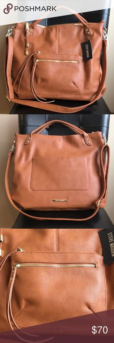 "Steve Madden Saddle tan Tote Handbag Great large Tote to shop around with or carry to work . Top zip closure. Both the exteriors front and back have functional pockets . Bag also has detachable long strap . Lots of room height is approximately 15"" and top width 16"" . Steve Madden Bags Totes"