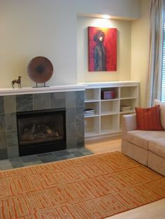 maybe use Expedit next to fireplace in basement?