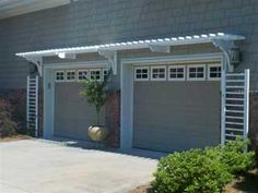 I like the simple trellis for a vine on the sides of the garage door.