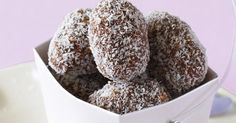 Sweet truffles made from coconut, cocoa and chopped walnuts.