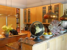 The Westchester house that Kitty Hawks and her husband Larry Lederman have spent 24 years perfecting:  atop the kitchen counter a vintage globe shares space with a copper fish.