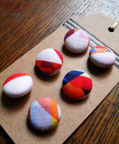 Six unique handmade fabric covered buttons by PixelAndThread