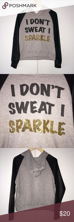 'I DONT SWEAT, I SPARKLE' Hoodie ✨ Perfect for my fabulous fashionistas out there . I wore this only once and it is like brand-new but unfortunately as I was listing it I realized there's a small hole in the back lower area of the hoodie. Look at the 5th picture attached. I suppose it can be sown or worn just as is because it's not very visible. Faux leather sleeves. Light material. No size or content listed. Good for size S and M. Cleo Tops Sweatshirts & Hoodies