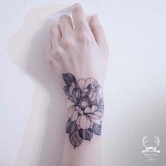 Flower Design for Women's Wrist Tattoo Idea