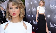 Taylor Swift stuns in a sexy crop top and slit skirt #DailyMail