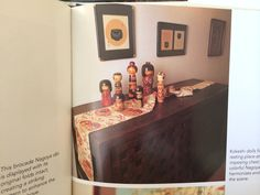 Japanese Obi on chest with kokeshi dolls. Photo from book Design with Japanese Obi by Diane Wiltshire and Ann Wiltshire.