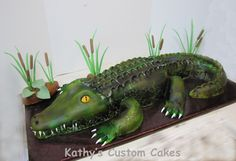 Louisiana Alligator Cake - This was the first cake I made using my new airbrush machine.  I learned a valuable lesson....airbrush doesn't stick to shortening.  I used shortening on my impression mat and the seams.  I should have brushed the whole thing down with powdered sugar before airbrushing.  Still, he came out pretty awesome.  He was almost 3 feet long.  I made this for a little boy's 10th birthday.   I added a picture of what it looked like cut, that is always neat to see.  For ...