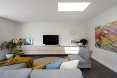 An light filled living area that opens directly out on to the adjoining pool - a great place to sit while watching the children have fun! Interior Designers Melbourne, Building Design, Great Places, Living Area, Packaging Design, Corner Desk, Architecture Design, Couch, Children