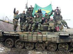 G.H.: Bandeira do Brasil é hasteada em área rebelde no l...