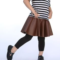 Learn how to make an adorable girl's skirt in only 20 minutes. Vegan leather circle skirt tutorial.