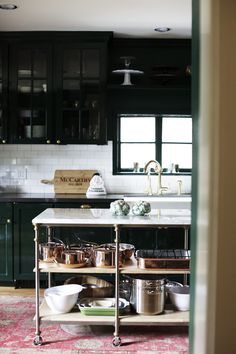Bailey McCarthy www.biscuit-home.com feature in February Matchbook Magazine   black white kitchen, subway tile, black cabinets, copper pans, brass hardware