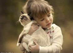 The photographer shows the moving moment a girl cuddles her cat - the pictures were taken in Moscow and Andreapol, in Russia