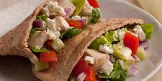 This classic Greek Chicken Pita features tender chicken breast, tomato, cucumber, a tangy lemon herb dressing, and most importantly crumbled feta cheese.