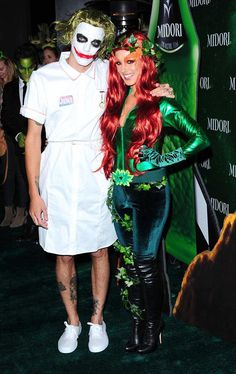 "ShenaeGrimes.husband.jpg -- Watch out! Poison Ivy is on the loose. ""90210"" star Shenae Grimes dressed up as the sexy ""Batman"" villainess and turned heads with her flaming red hair and skintight costume at the Third Annual Midori Green Halloween Party. She posed alongside the joker. (10/29/13) Credit: Startraks Photo"