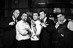Awesome groomsmen wedding photo ideas - tough guys with cigars