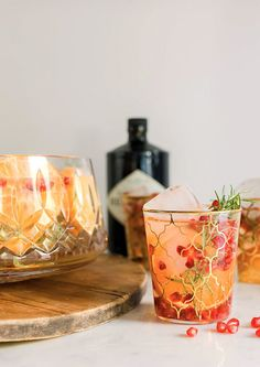 Orange, pomegranate & rosemary gin punch recipe by @waitingonmartha 1 BOTTLE CHAMPAGNE OR PROSECO 8 OUNCES POMEGRANATE JUICE 4 OUNCES GIN 8 OUNCES ORANGE JUICE 4-6 ORANGES, THINLY SLICED 1 CUP POMEGRANATE SEEDS 4-6 SPRIGS OF ROSEMARY PLUS MORE FOR GARNISH INSTRUCTIONS COMBINE ALL INGREDIENTS TOGETHER IN A PUNCH BOWL, LIGHTLY STIR. ADD ICE TO A LOW BALL GLASS OR PUNCH BOWL AND POUR OVER ICE TO SERVE.
