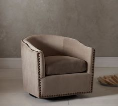Harlow Upholstered Swivel Armchair | Pottery Barn I love this round-back swivel chair!