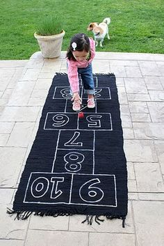 Get the kids playing inside with this homemade hopscotch made from a rug runner.