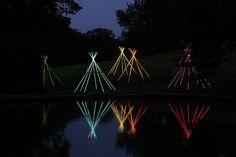 "Bruce Munro's ""Light Reservation"" of 10 tepee-like constructions at Cheekwood Botanical Garden."